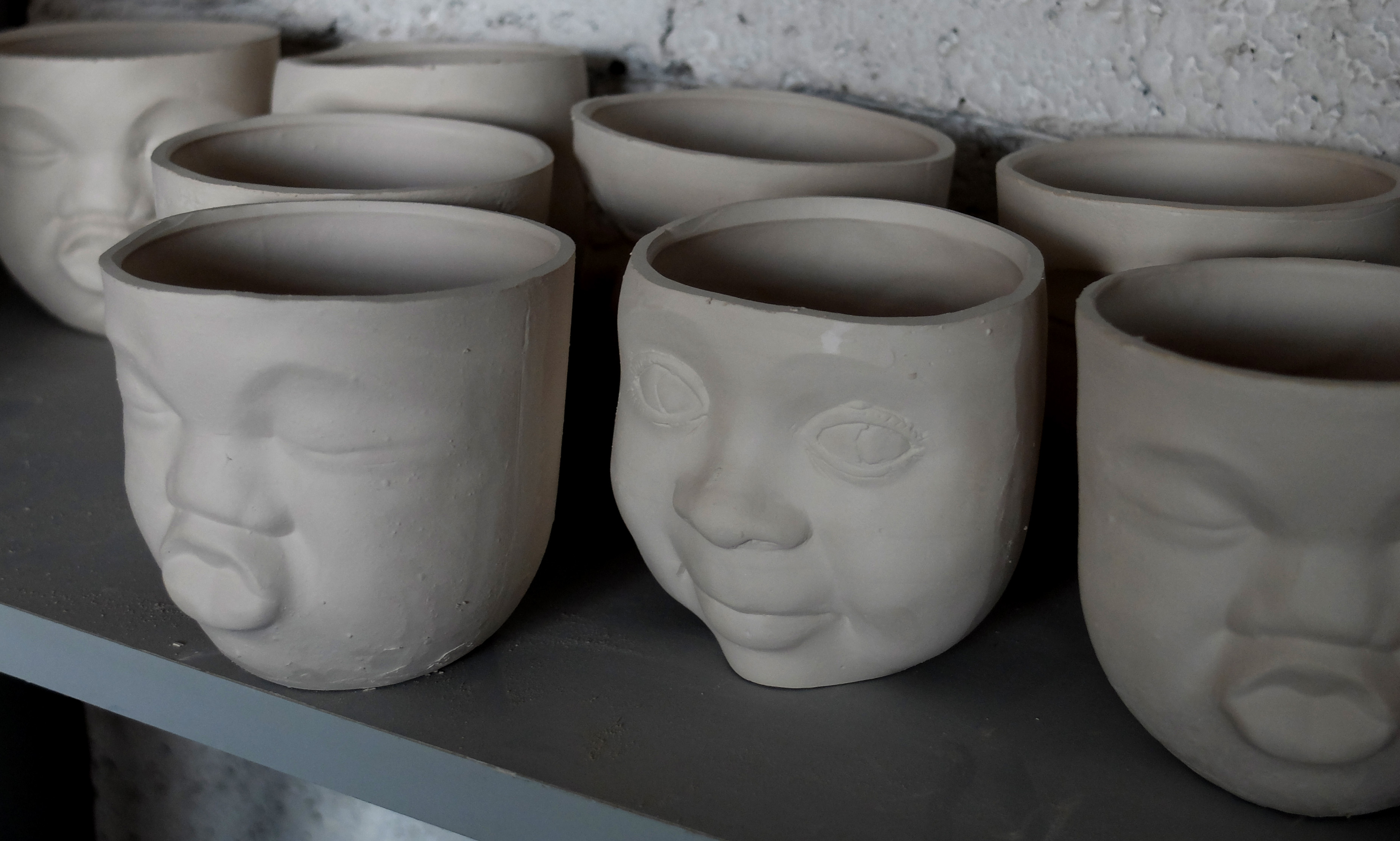 Faces before firing